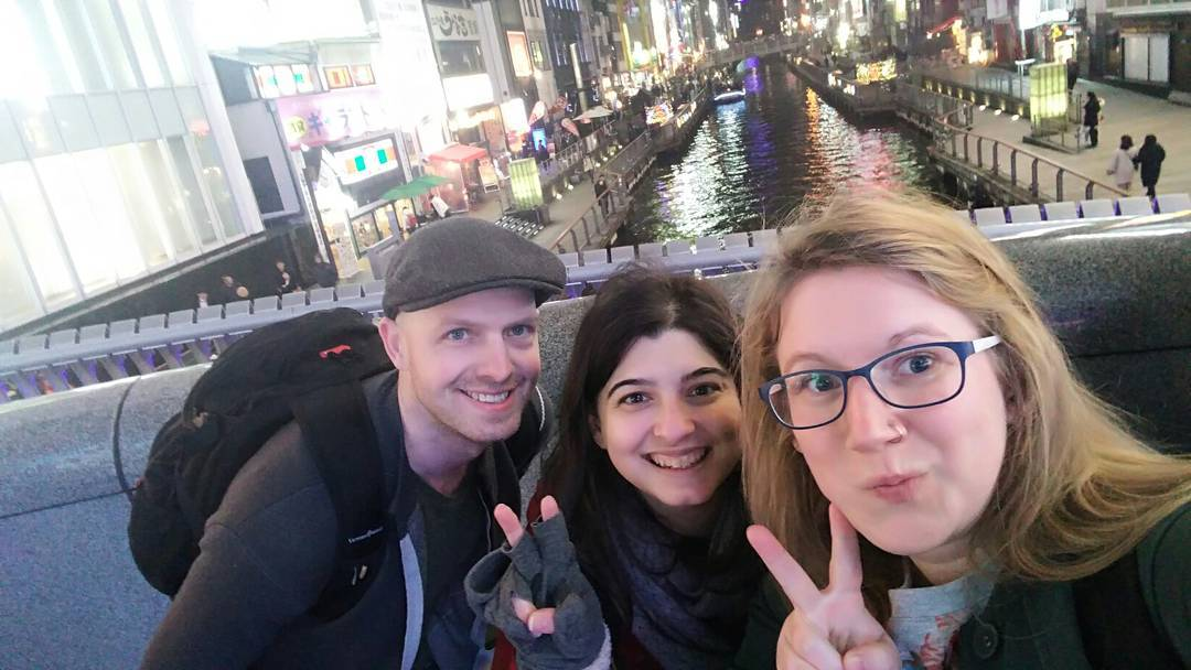 Levi, Amy and Nancy standing on a bridge in Osaka